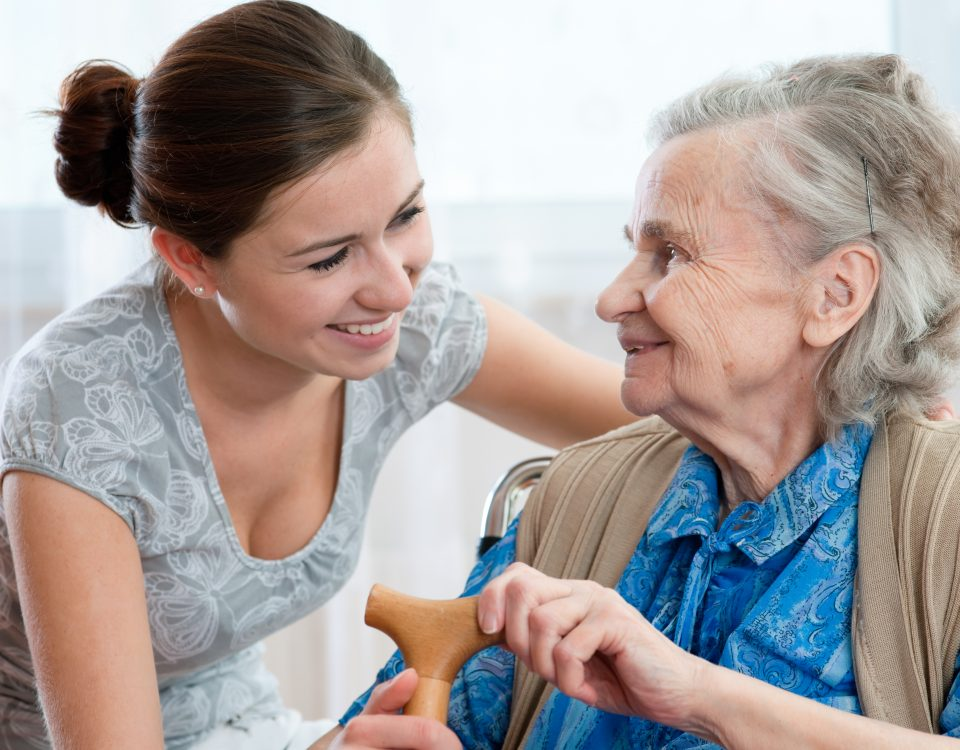 An elderly woman assisted by her personal home care attendant